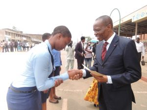 Peace Eberechukwu, Student from P.S.S.Mankon -Winner of essay contest receives her prize from the Governor of the NW Region of Cameroon