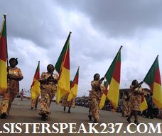 Cameroon women wave the national flag proudly as a true mark of their patriotism